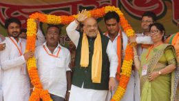 BJP President Amit Shah being welcomed with a garland at an election meeting in Kalyani on Wednesday. Picture by Abhi Ghosh