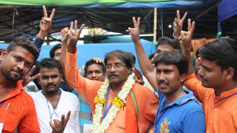 BJP winning candidate Jagannath Sarkar outside the counting venue in Ranaghat on Thursday