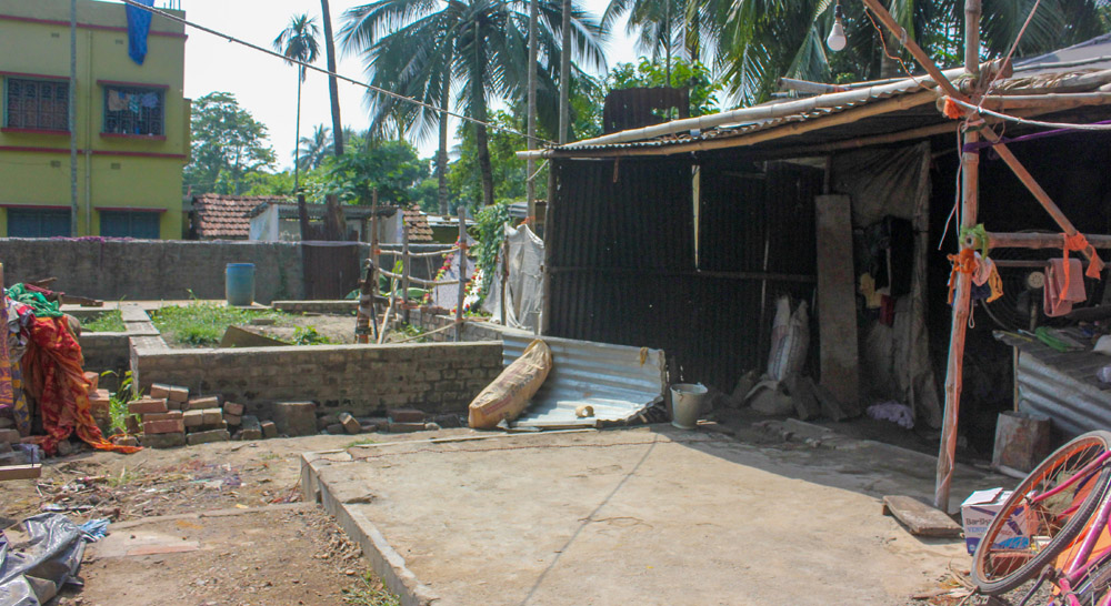 Foundation of incomplete building of Paresh Sarkar and his temporary tarpaulin shed