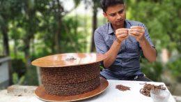 Anupam weaving string of apple seeds