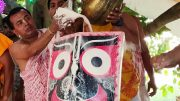 The deity of Lord Jagannath being given the bath at Rajapur temple