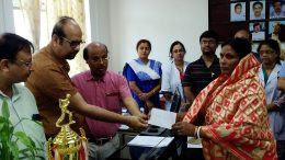 Mamata Biswas, mother of slain jawan Sudip Biswas receiving the cheque