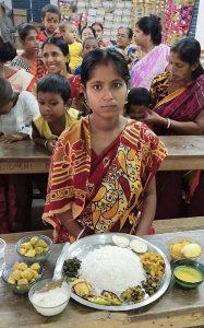 Moumita posing with platter