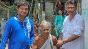 Biswajit Roy (blue dress) and Subrata Moitra (white dress) with Saraswati Guin