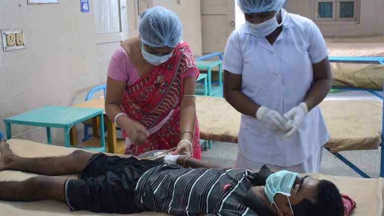 Asit Sarkar being examined by medical staff