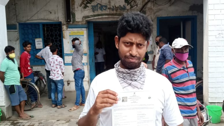 Pratap Chandra Das with the birth certificate of his newborn son