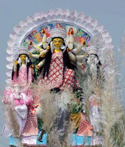 A deity of Goddess Durga being taken to Puja pandal in Santipur