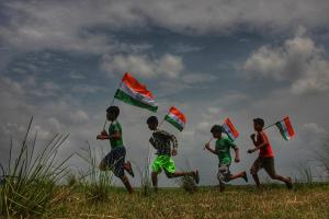 Children running with National Tricolor on the occasion of 71st Independence day in Santipur